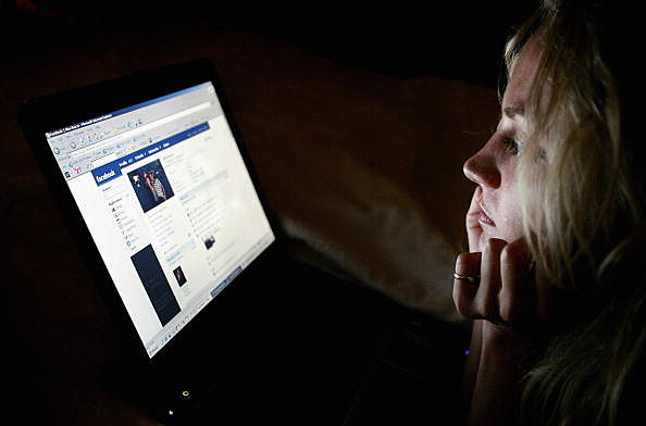 Girl browses the social networking site Facebook
