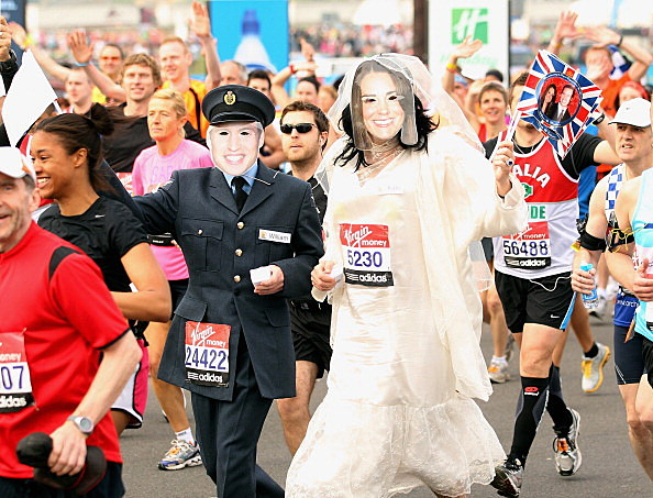 Two competitors dressed as Prince William and his fiancee Kate Middleton at 2011 Virgin London Marathon
