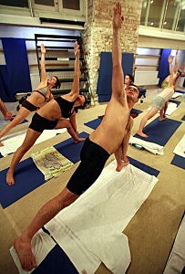 Students Practice The Unique Bikram Yoga