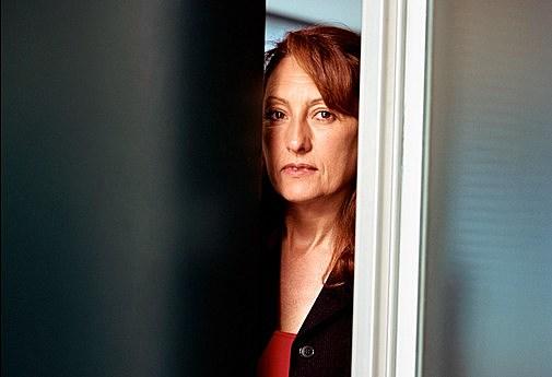 Businesswoman looking through door, Buenos Aires, Argentina